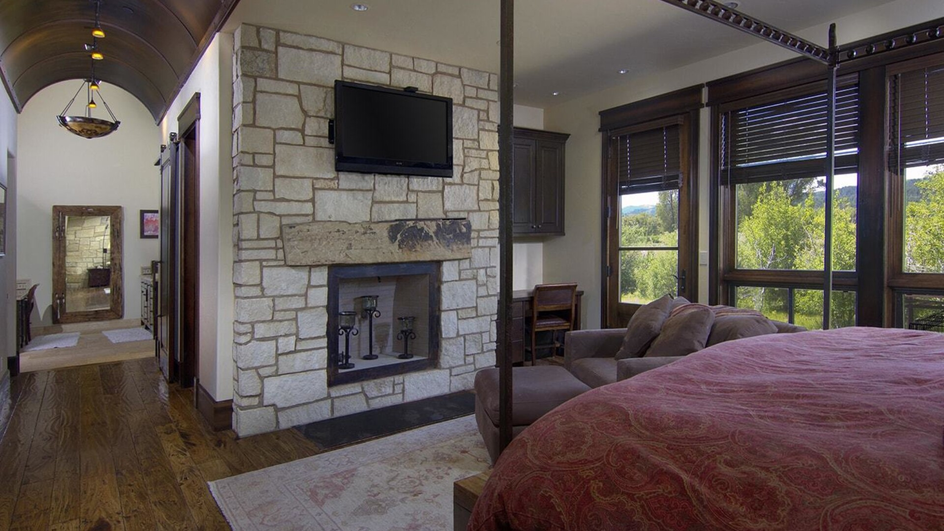 stone fireplace in a bedroom in a mansion in jackson hole wyoming