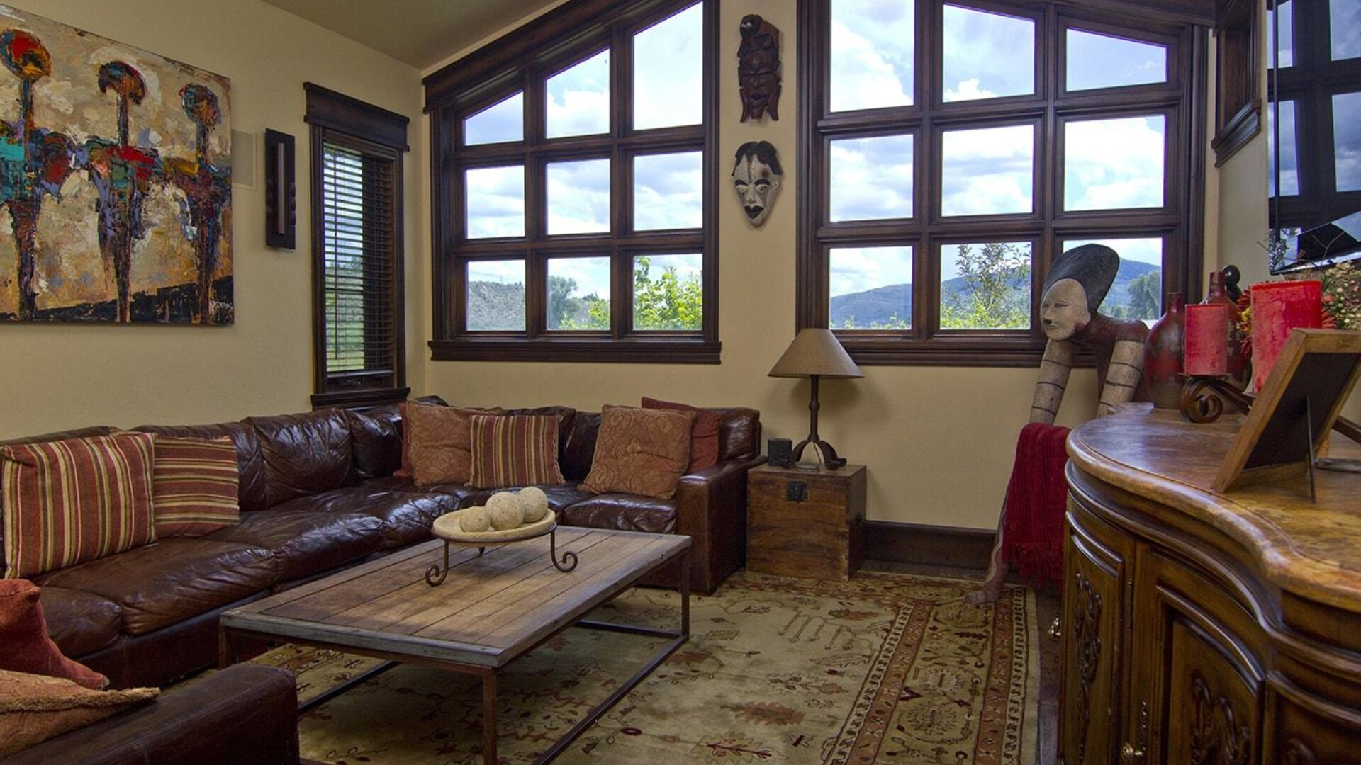 large rustic living room area with tall windows