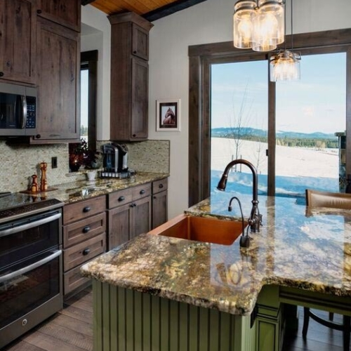 kitchen interior with large stone island and wooden cabinets