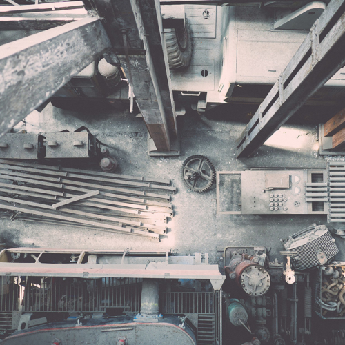 top down view of a construction area with steel beams, tools and concrete